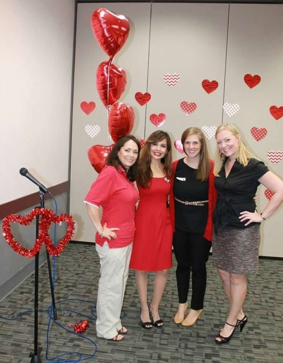 """Women decked out in red converged on the Humble Civic Center for """"Go Red Por Tu Corazon"""", a free outreach and educational event for women."""