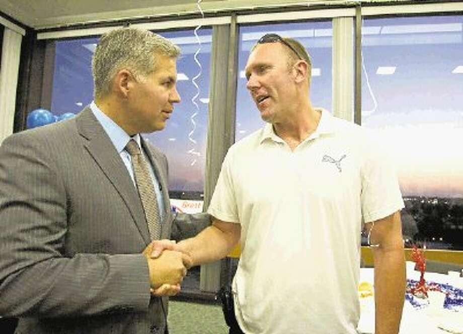 Warren Diepraam, right, went to work for Montgomery County District Attorney Bret Ligon, left, in 2009. Photo: Staff Photo By Eric Swist / @WireImgId=2583198