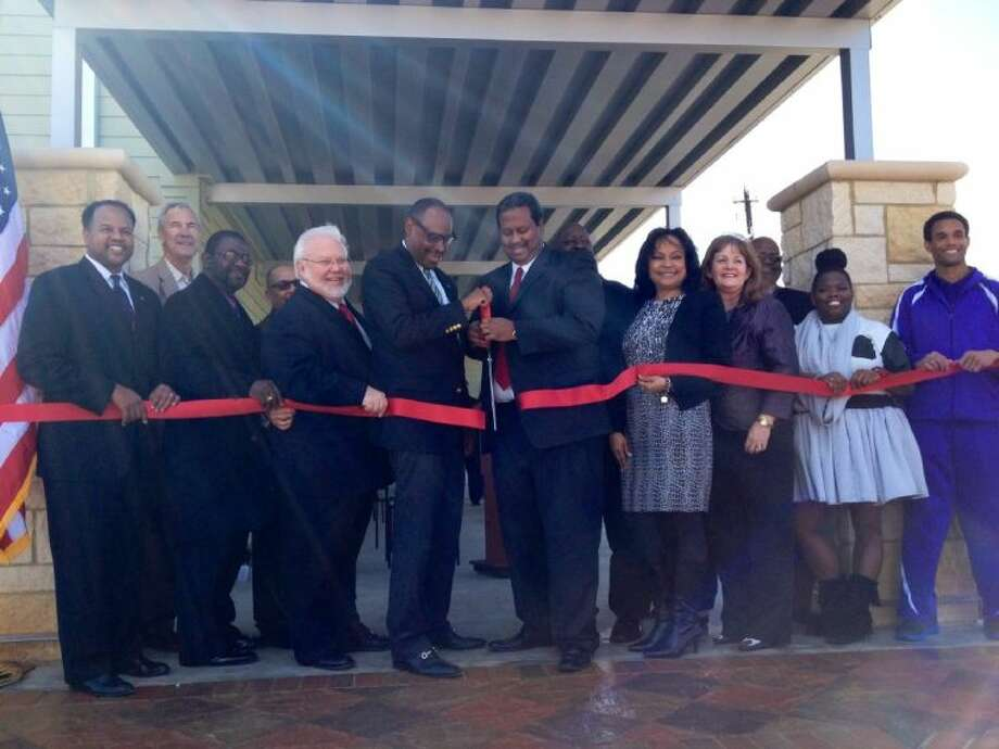 Left-right: State Rep. Ron Reynolds; Precinct 4 Commissioner James Patterson; HUD Field Director Dr. Pringle; Deputy Director Steve Tinnermon; Houston City Council Member At-Large Michael Kubosh; District K Houston City Council Member Larry Green; Precinct 2 Commissioner Grady Prestage; Precinct 2 Constable Ruben Davis; Pinnacle Center Manager Sonya Santee; County Clerk Diane Wilson; Director City of Houston Health and Human Services Stephen Williams; Renita Thompson; Charles Freeman IV. Photo: Fort Bend County Judge's Office