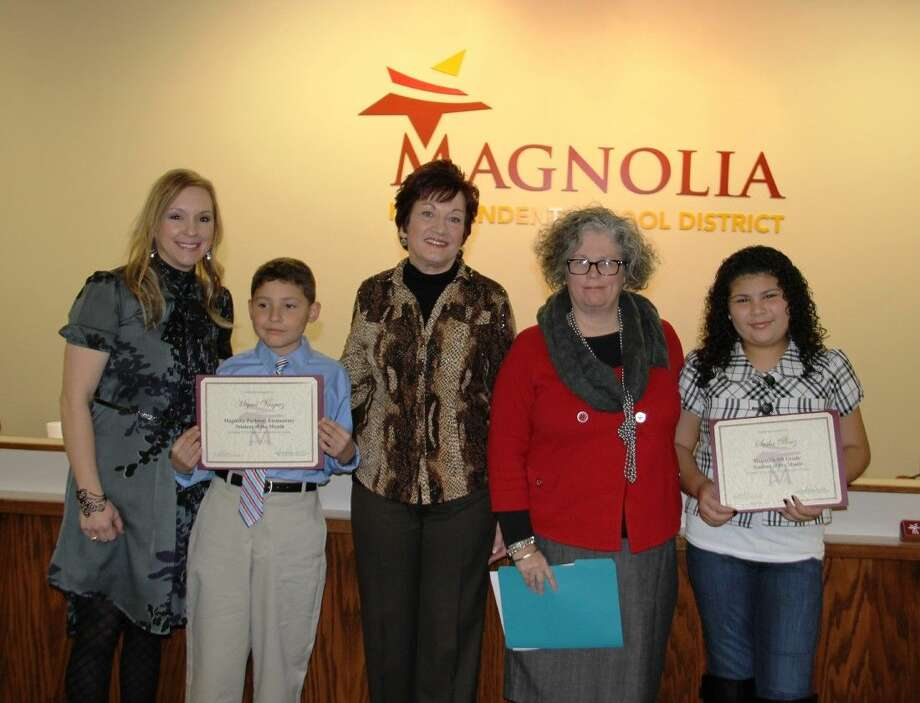 Pictured, from left, are Principal Stacey Zielonka from Magnolia Parkway Elementary, Miguel Vasquez, School Board President Deborah Rose Miller, Principal Lisa Bertrand from Magnolia Sixth, and Sasha Perez. Photo: MISD