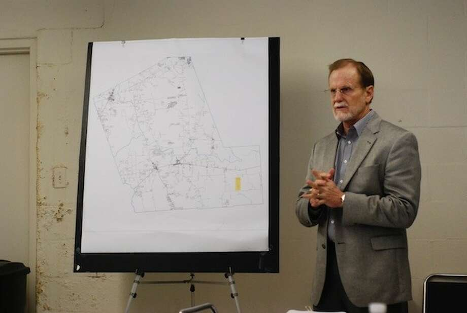 J. Rice of Public Management led a workshop Tuesday, Feb. 25, for county commissioners about the creation of a Transportation Reinvestment Zone. Photo: CASEY STINNETT / Houston Community Newspapers, 2014
