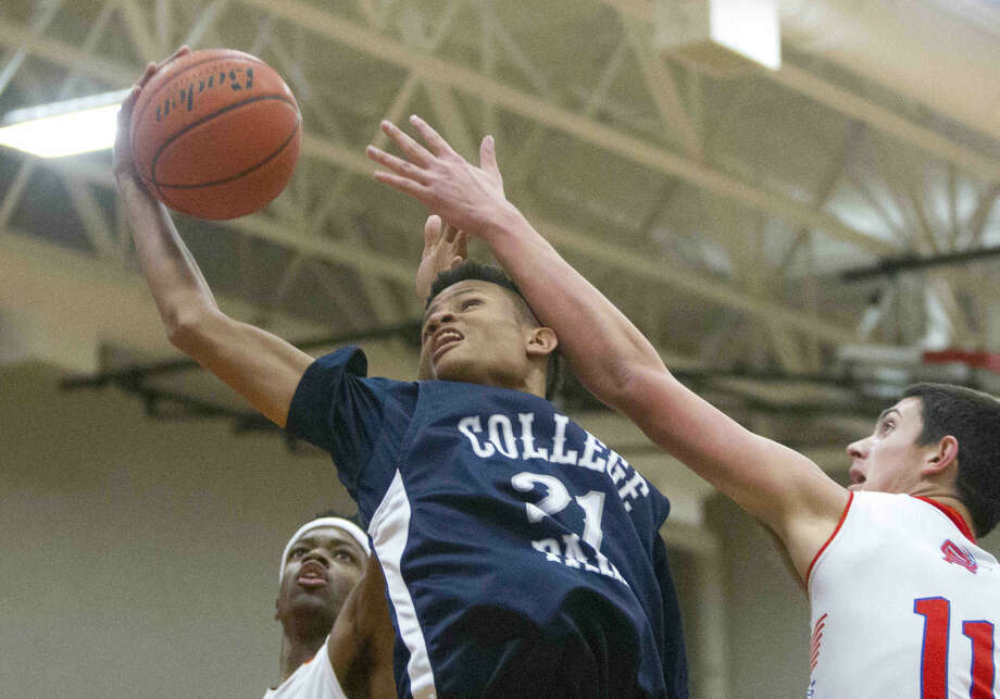 College Park's Jordan Gilliam grabs a rebound during a high school basketball game Tuesday. To view or purchase this photo and others like it, visit HCNpics.com.