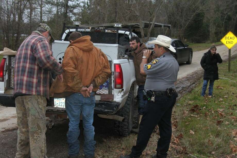 Pct. 5 Constable Warren Despain and Deputy Constable David Hunter question two suspects taken into custody around 5:30 p.m. Tuesday, Jan. 13, on CR 2170-5 in Tarkington. The pair reportedly evaded law enforcement and fled into a wooded area to avoid apprehension.
