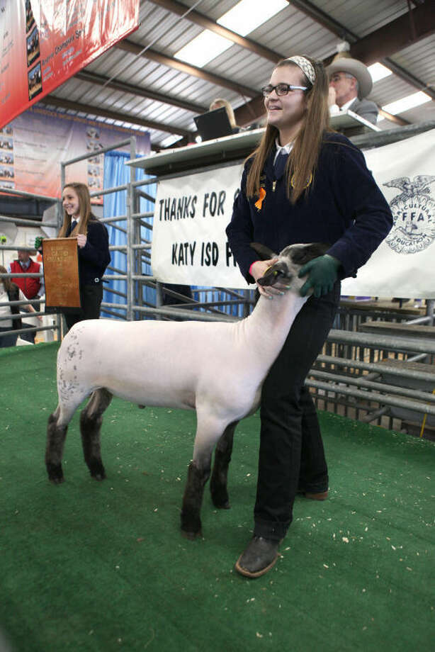 Kayla Powers with her Grand Champion Lamb during the 2014 Katy Independent School District FFA Livestock Show & Rodeo auction at the L.D. Robinson Pavilion in Katy on Saturday, February 22, 2014.