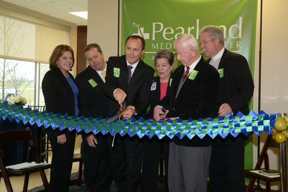 "HCA Gulf Coast Division President, Maura Walsh; Pearland Medical Center Board of Trustees Chairman, Kevin Fuller; Pearland Medical Center CEO, Matt Dixon; Manvel Mayor, Delores Martin; Pearland Mayor, Tom Reid; and Reverend Brian Gigee ""Cut the Ribbon"" on Friday, January 9th for the new 71 million Pearland Medical Center. Photo: Charles Falk"