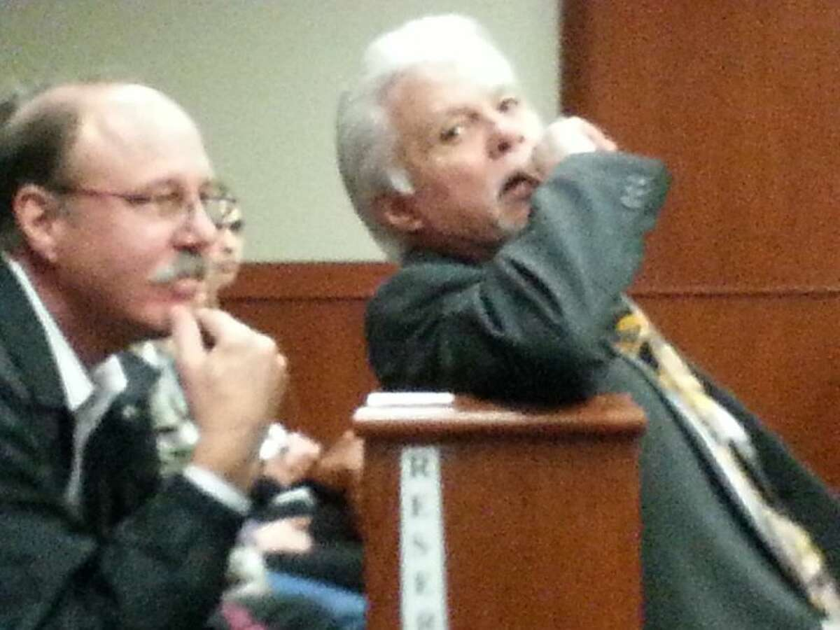 Doris Walters' son-in-law Donny Kelley (left) and Ronnie Bird (right) at Billy Gene McDade's court date Monday, Feb. 18.