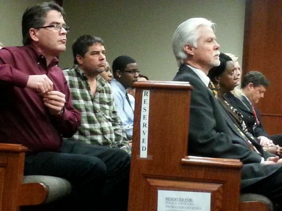 Doris Walters' son Billy Hutchinson (front left) and Ronnie Bird (front right) watch Billy Gene McDade go before Judge Cliff Vacek at the Fort Bend County Justice Center Monday, Feb. 17. Photo: Zach Haverkamp