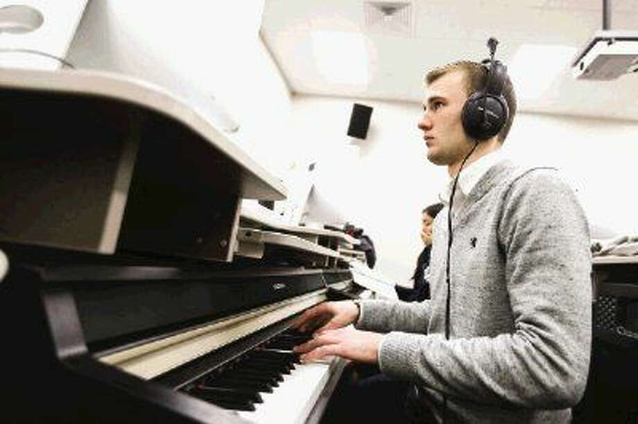 Sophomore Brian Sowell pays piano during his Class Piano course on Monday, Jan. 12, 2015, at LSC-Montgomery.