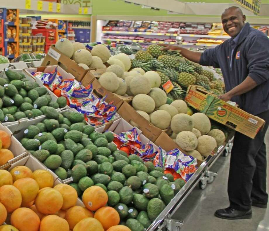 Nathaniel Payne started working for Aldi one and years ago and is now training to become a manager. He was spotted unloading fresh produce at the Aldi store in Kemah, Photo: KRISTI NIX