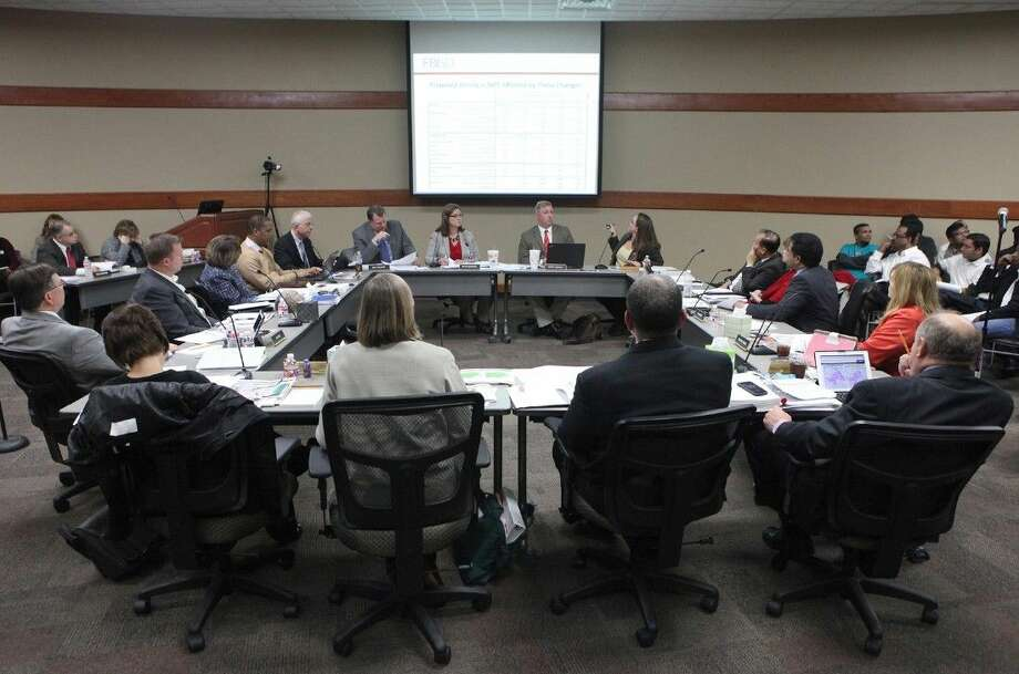 The Fort Bend ISD Board of Trustees discusses a proposed district-wide feeder pattern and attendance boundary plan at the FBISD Administration Building in Sugar Land on Monday, Jan. 12. Photo: Alan Warren