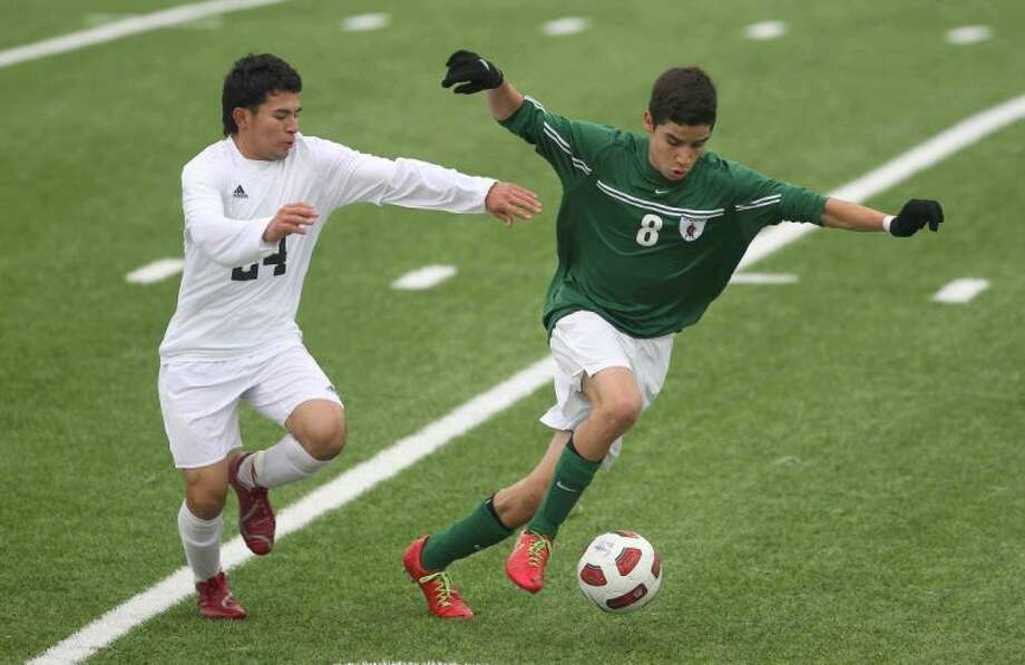 The Woodlands' Tony Arana (8) controls the ball as Conroe's Jairo Montiel (24) defends during a high school boys soccer game Wednesday. The Woodlands defeated Conroe 2-1. To view or purchase this photo and others like it, visit HCNpics.com. Photo: Jason Fochtman