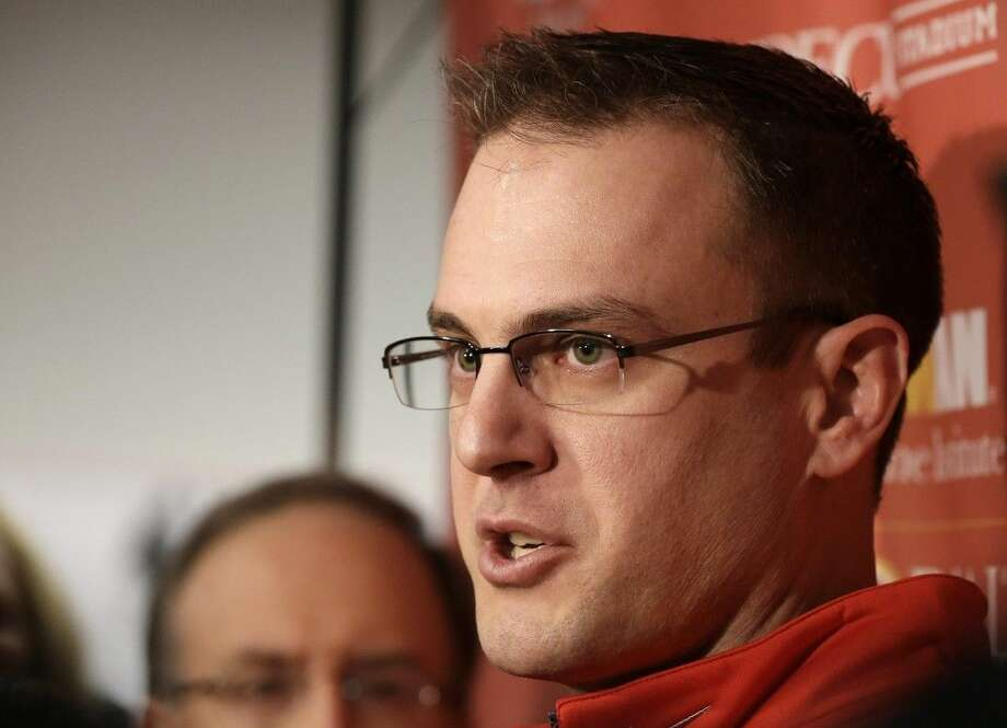 New Houston head football coach Tom Herman meets with the media on Wednesday.