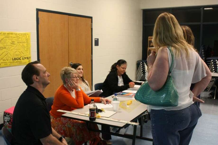 The mathematics department at Shepherd High School answers questions for an inquiring parent. From left to right behind the table are Andy Brown, Sharon Dietz, Julia Albright and Susan Schlagel. Photo: JACOB MCADAMS