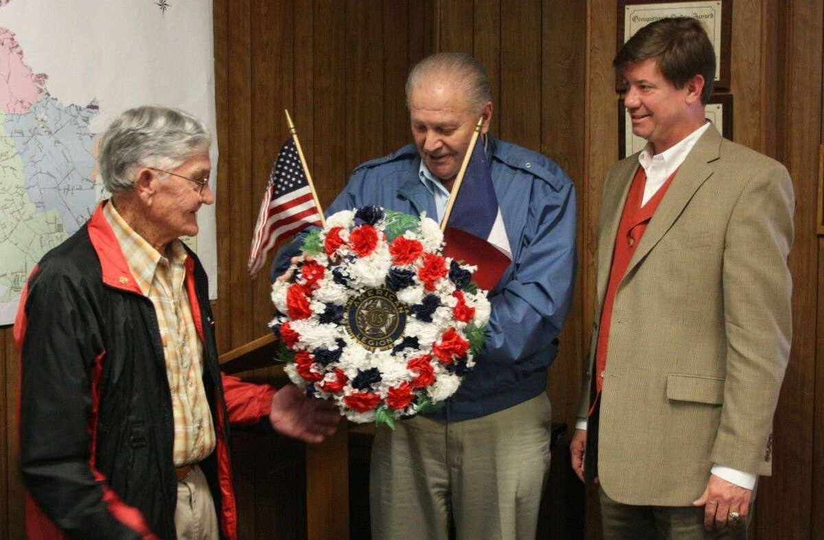 Veterans Service Officer Dale Everitt (middle) and County Judge John Lovett (right) present Leon Copeland a wreath wrapped around a plaque commemorating his cousin Clyde Copeland's sacrifice during World War II. The plaque was presented on Jan. 12 during the San Jacinto County Commissioners Court. Seventy years prior on Jan. 11, Clyde Copeland gave his life in service to the United States military during World War II.