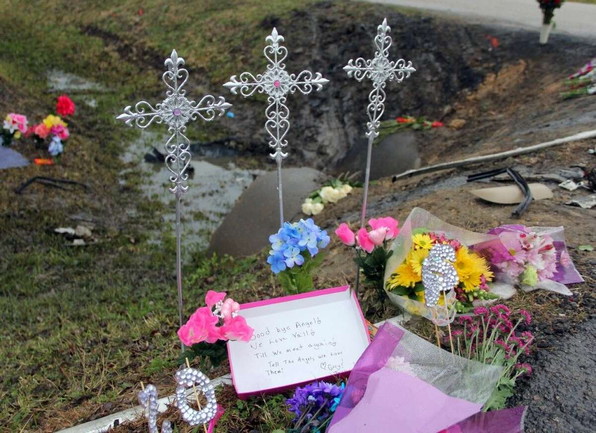 Three crosses and other tokens and flowers were left at the site of a car crash that took the life of three teenagers Monday (Jan. 7).