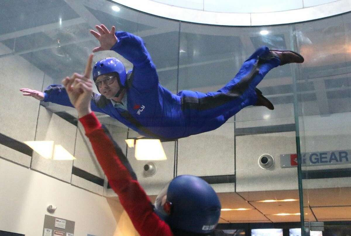 State Representative Dwayne Bohac flies with the help of Flight Instructor Rory Corrigan at iFLY indoor skydiving in Houston, Texas on Thursday, January 8, 2015.