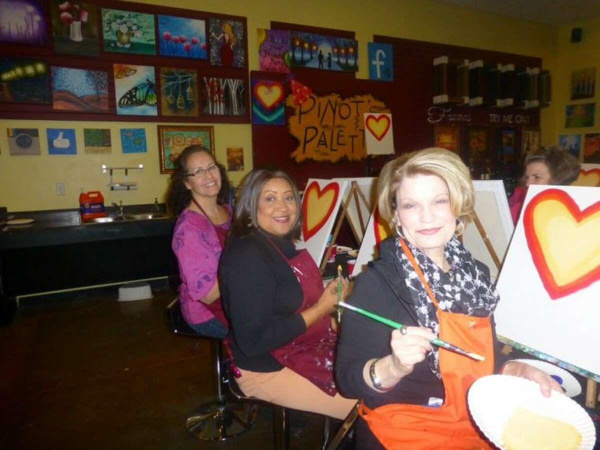 (Left to right) Pamela Fisher, Mattie Tyo and Evelyn Houghton, breast cancer survivors at the MD Anderson Regional Care Center in Sugar Land, release their inner artists during the February Breast Friends meeting held at Pinot's Palette in Sugar Land Town Square.