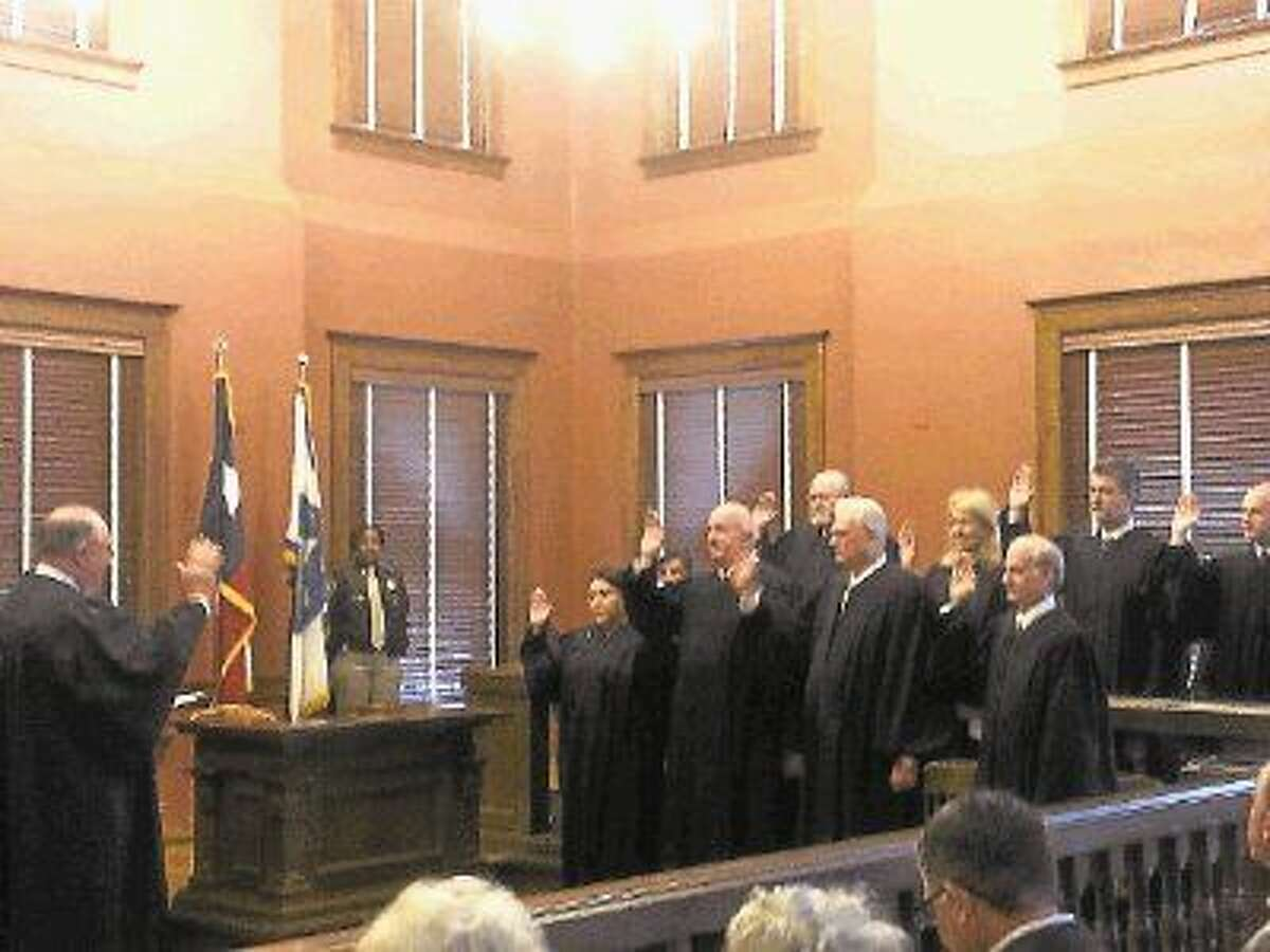 District Court and County Court judges are sworn in for their new terms in office by 434th District Court Judge James Shoemake at the Fort Bend County Courthouse on Thursday, Jan. 1.