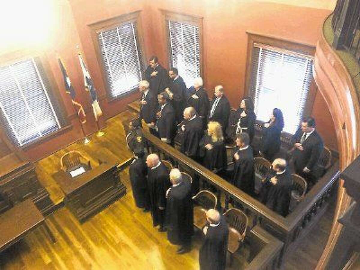 Fort Bend's most recently elected public officials say the pledge prior to the swearing-in ceremony at the Fort Bend County Courthouse on Thursday, Jan. 1.