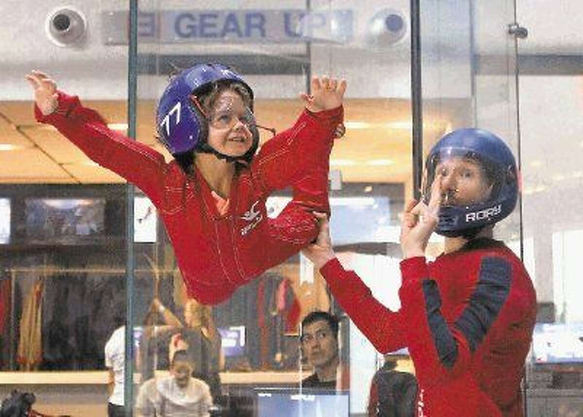 Thomas Rincon 6, flies with Flight Instructor Rory Corrigan at iFLY indoor skydiving in Houston, Texas on Thursday, January 8, 2015.