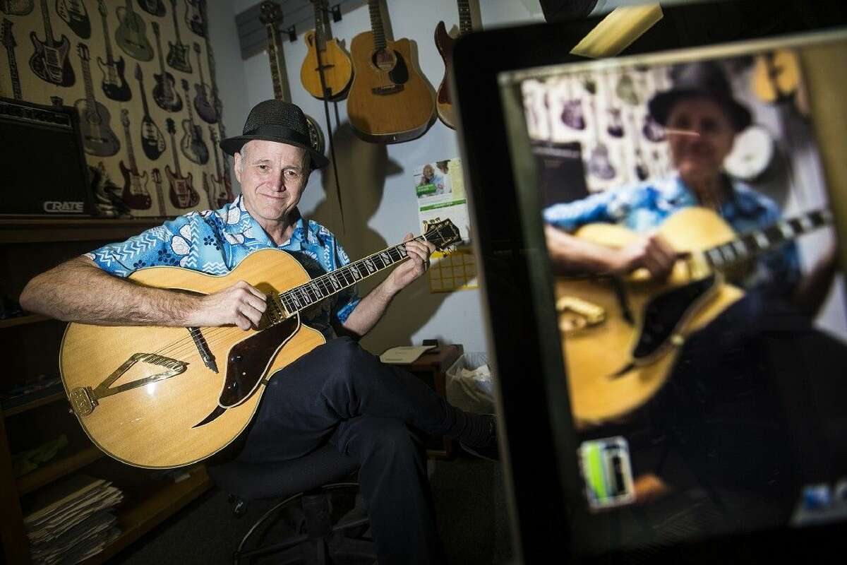 Guitarist Brian Turner sits for a portrait Jan. 15, 2015, at Humble Music Center. Turner has been using online technology, such as Skype and FaceTime, to teach guitar across America for three years with his farthest student learning from the Bahamas.