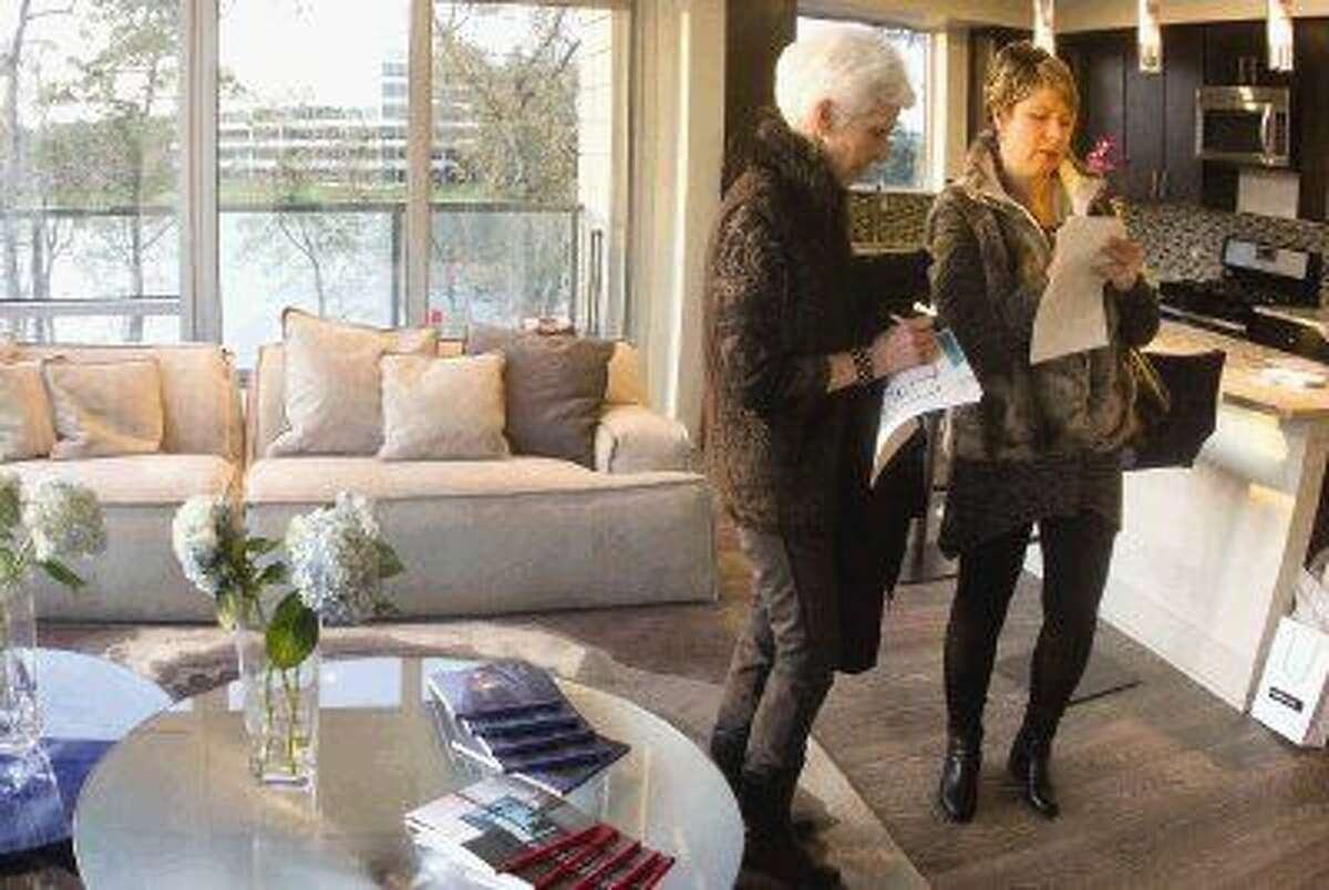 Visitors Thursday during a tour of a 1,560-square foot apartment at One Lakes Edge.