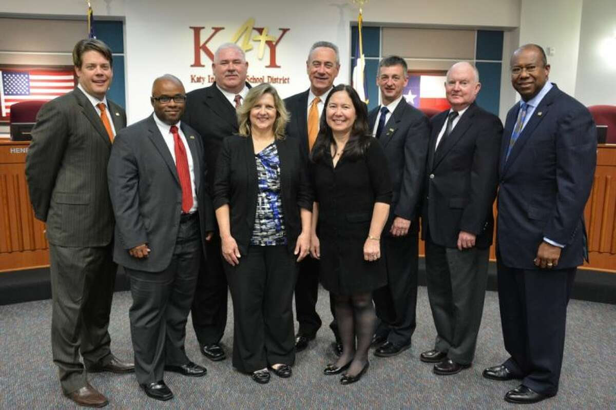 Back: Trustees Bryan Michalsky (left), Terry Huckaby, Joe Adams, Charles Griffin, Bill Proctor, and District Superintendent Alton Frailey. Front: Trustees Henry Dibrell, Rebecca Fox and namesake Keiko Davidson.