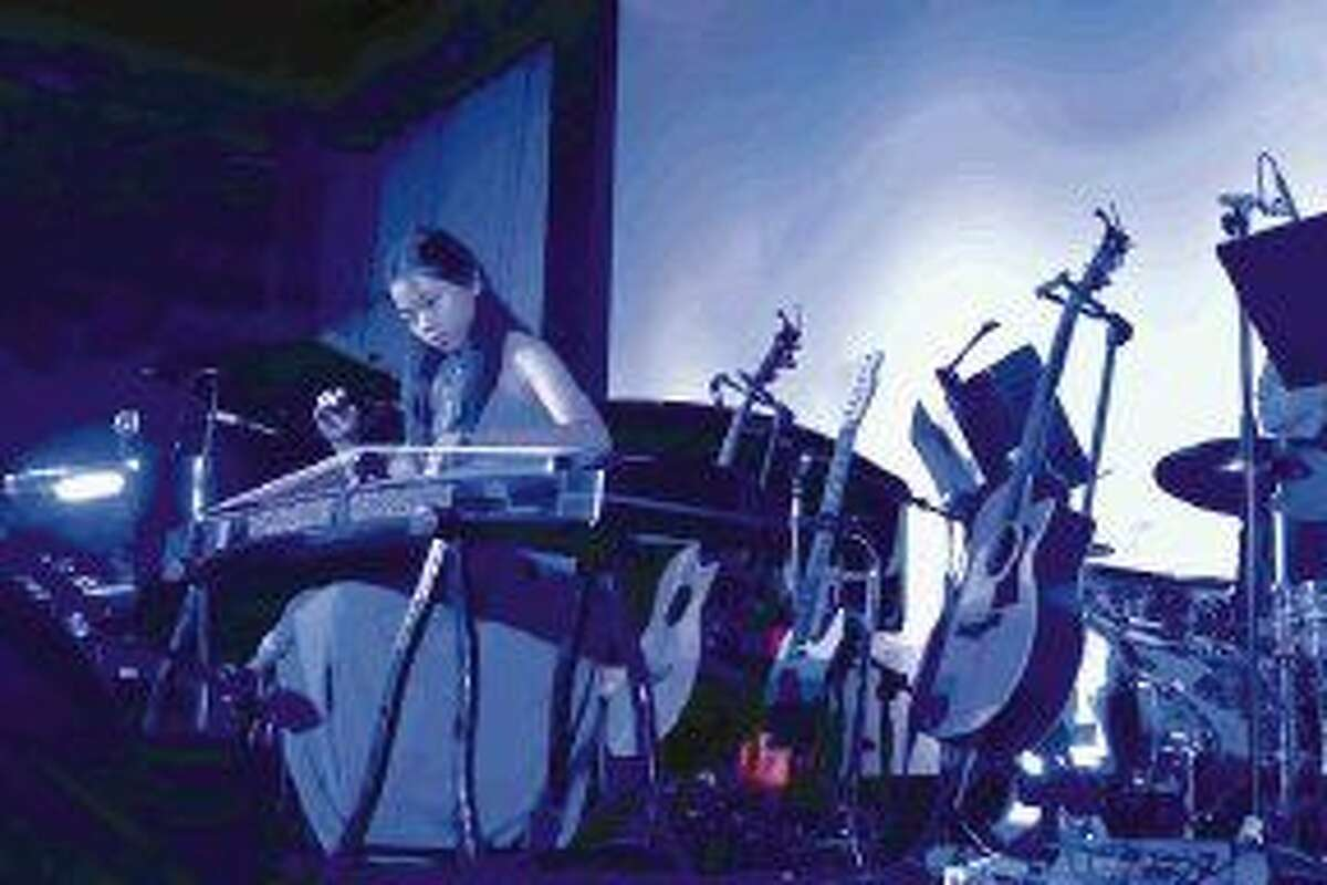 Michelle Zhang joins Music Doing Good in concert playing the Guzheng, a traditional Chinese instrument.