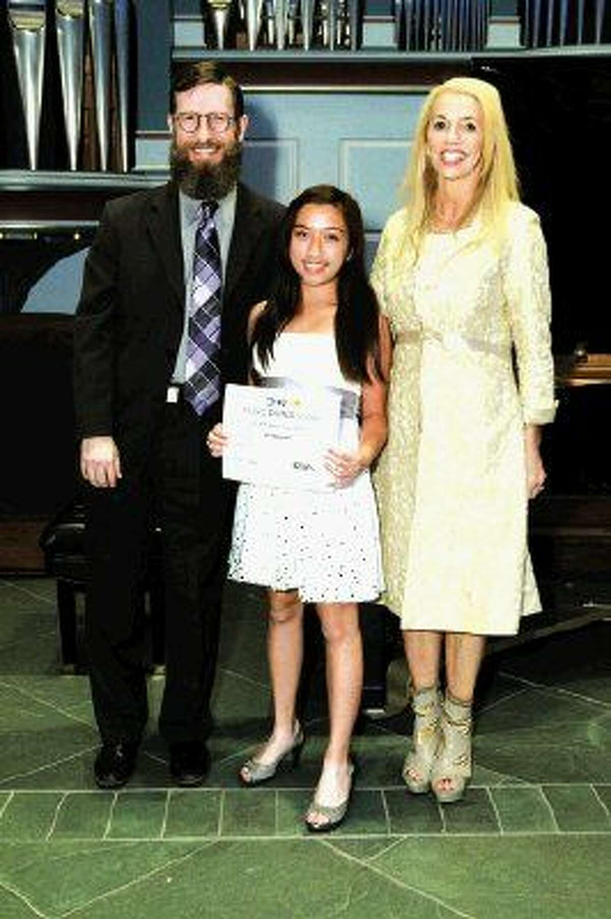 Pianist Vi Nguyen accepts her Music Doing Good scholarship certificate with program director Rodney Waters and president and founder Marie Taylor Bosarge.