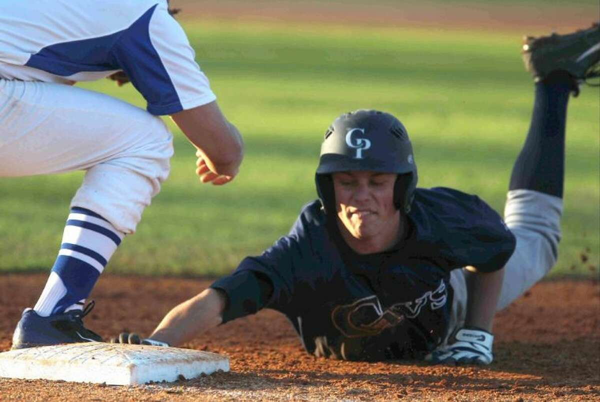College Park's Jacob Mardick reaches back to first base to avoid getting picked off during a game at the Ferrell Classic on Wednesday. College Park defeated Cypress Creek 9-1. To view or purchase this photo and others like it, visit HCNpics.com.