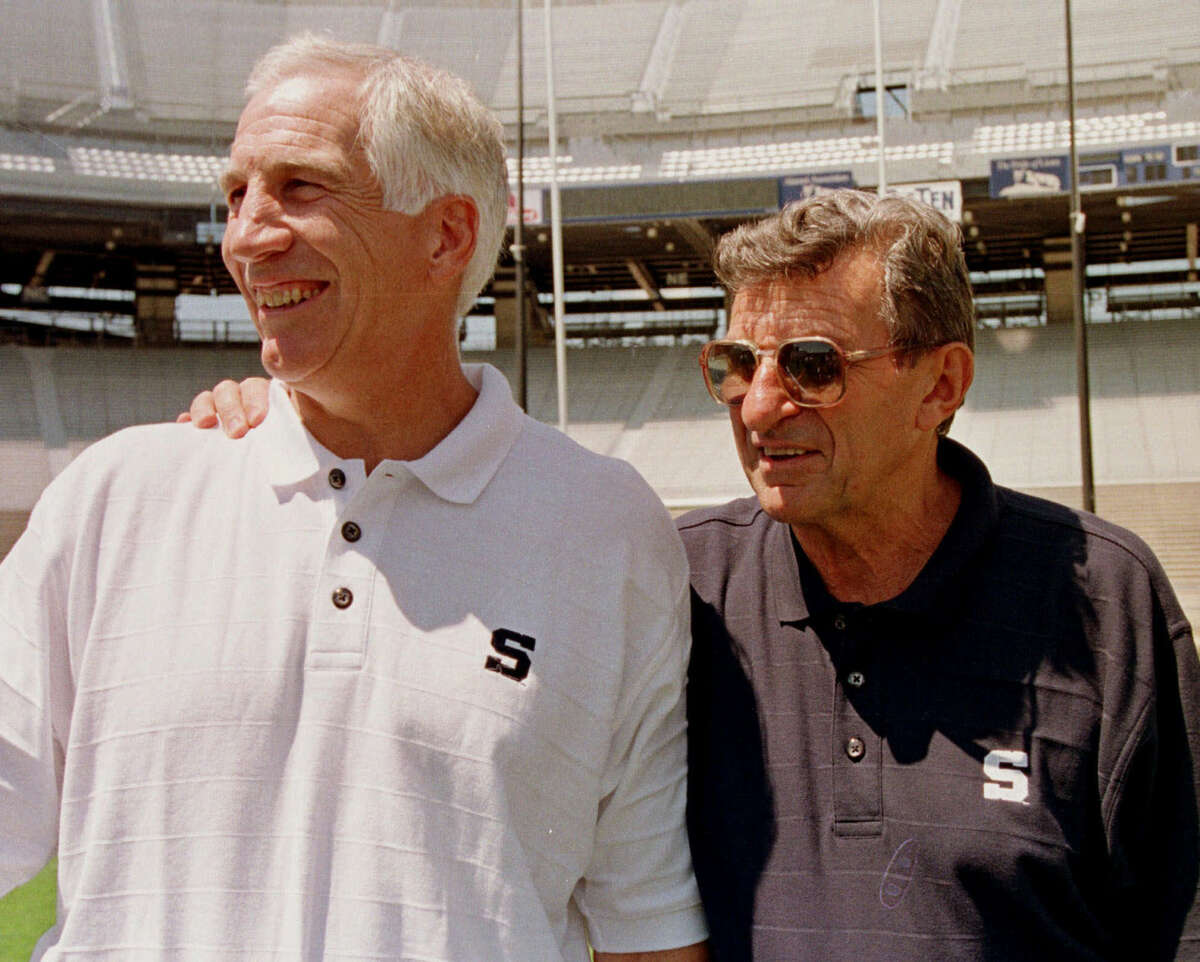 FILE - In this Aug. 6, 1999, file photo, Penn State head football coach Joe Paterno, right, poses with his defensive coordinator Jerry Sandusky during NCAA college football media Day at State College, Pa. A proposed settlement, announced Friday, Jan. 16, 2015, by the NCAA, will give Penn State back 112 football team wins that were vacated two years ago in the Sandusky child molestation scandal. If approved, the new agreement also would restore former coach Paterno's status as the winningest coach in major college football history with 409 victories. (AP Photo/Paul Vathis, File)
