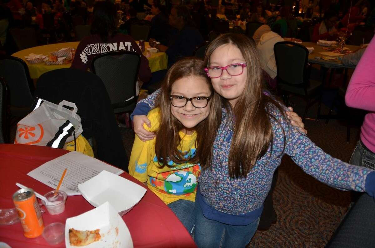 Birkes Elementary School fifth-grade student Laura Mallette and Fiest Elementary School fourth-grade student Marisa Goss enjoy the Annual Food Tasting at the Berry Center on Jan. 15.