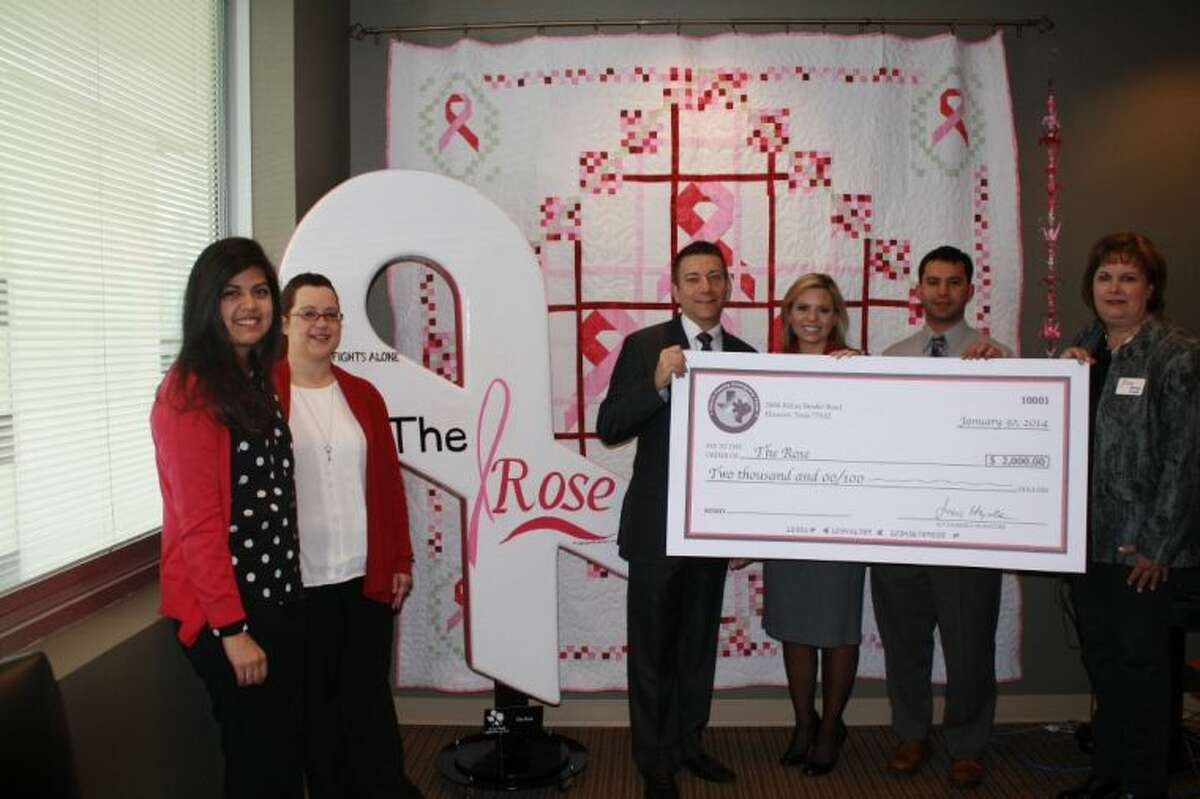 CEC directors presenting a $2,000 check to The Rose.
