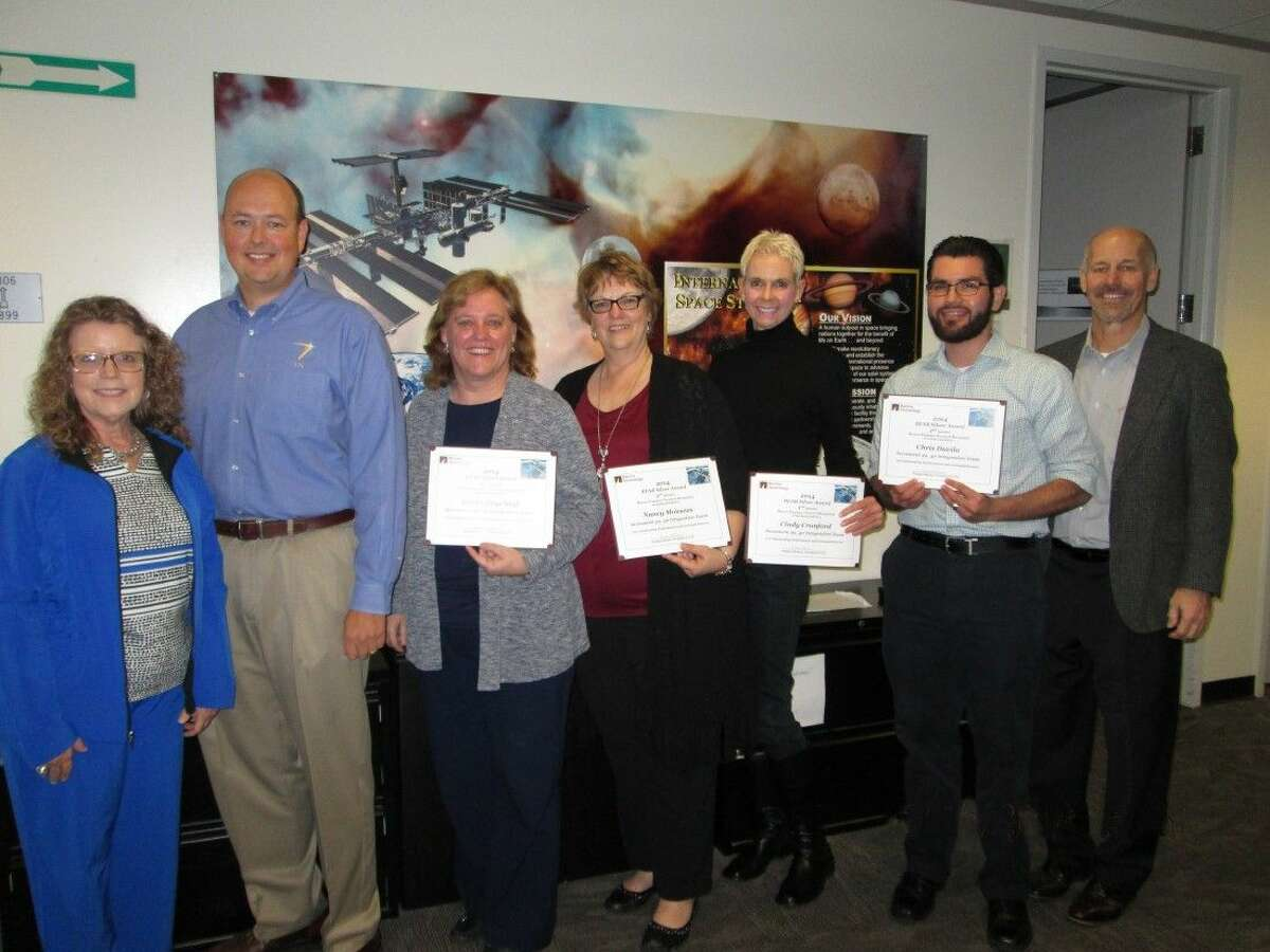 The MAPI Increment 39 and 34 Team recently received a Barrios Technology Silver BEAR Award. Pictured from left are Sandy Johnson, Barrios Technology President and CEO; Ryan Lien, Increment Manager for Increment 39 and 40; MAPI Team members, Karen Engelauf, Nancy Monsees, Cindy Crawford, Chris Davila; and Robert McAfoos, Barrios Technology MAPI Program Manager.