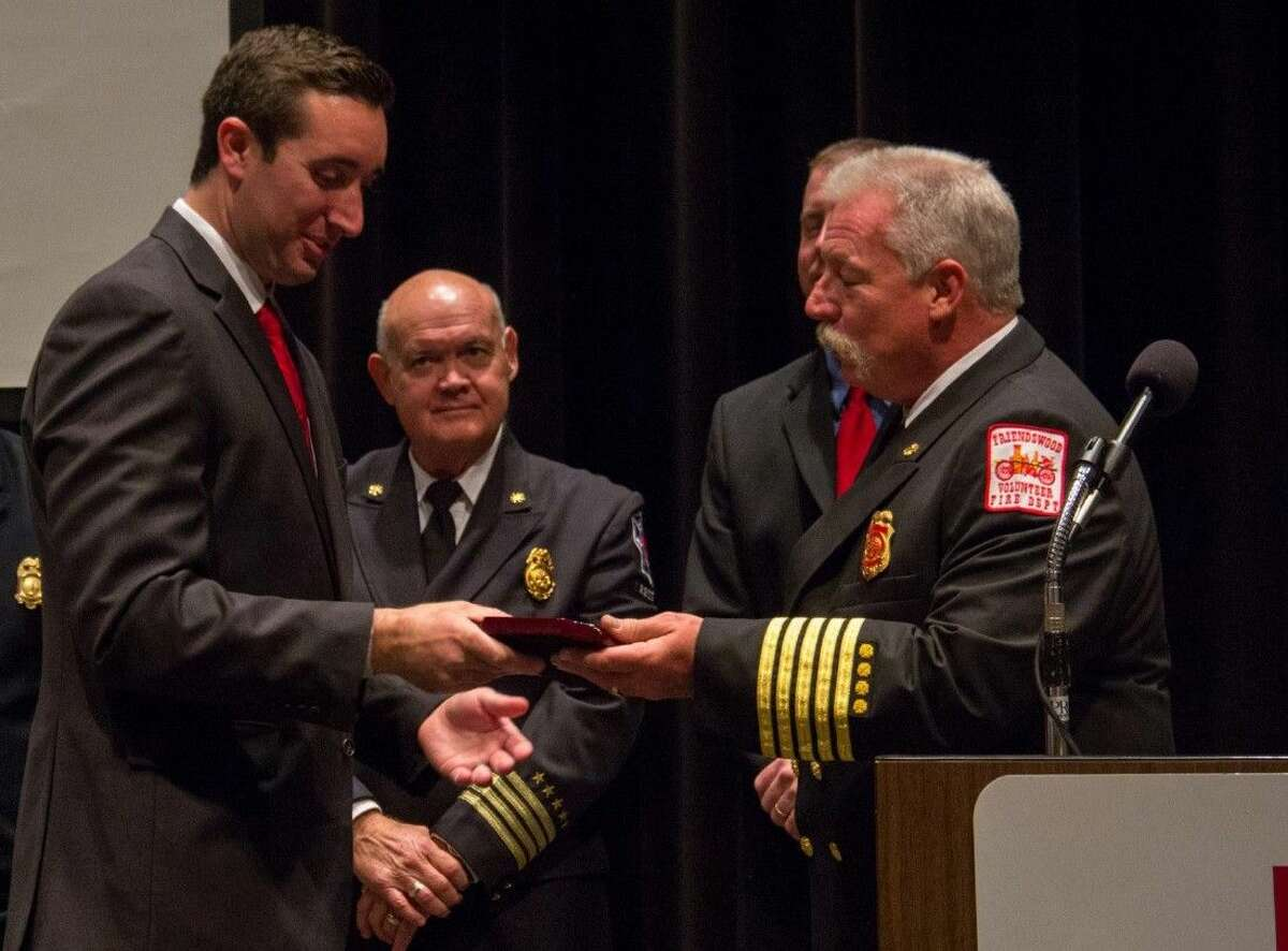 During the College of the Mainland Fire Academy graduation, Sean Hendry, left, won the President's Award and Highest Class Average Award for serving as class president and earning the highest GPA. Instructor Stan Kozlowski, right, presented the award with Director of Fire Technology Danny McLerran, center.