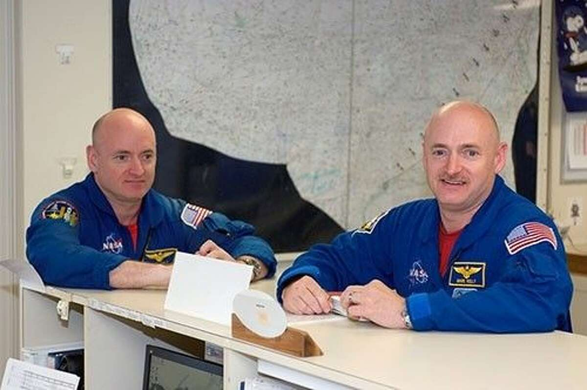Astronauts Mark Kelly (right), STS-124 commander, and Scott Kelly are pictured in the check-out facility at Ellington Field near NASA's Johnson Space Center as the STS-124 crewmembers prepare for a flight to Kennedy Space Center in NASA T-38 trainer jets.
