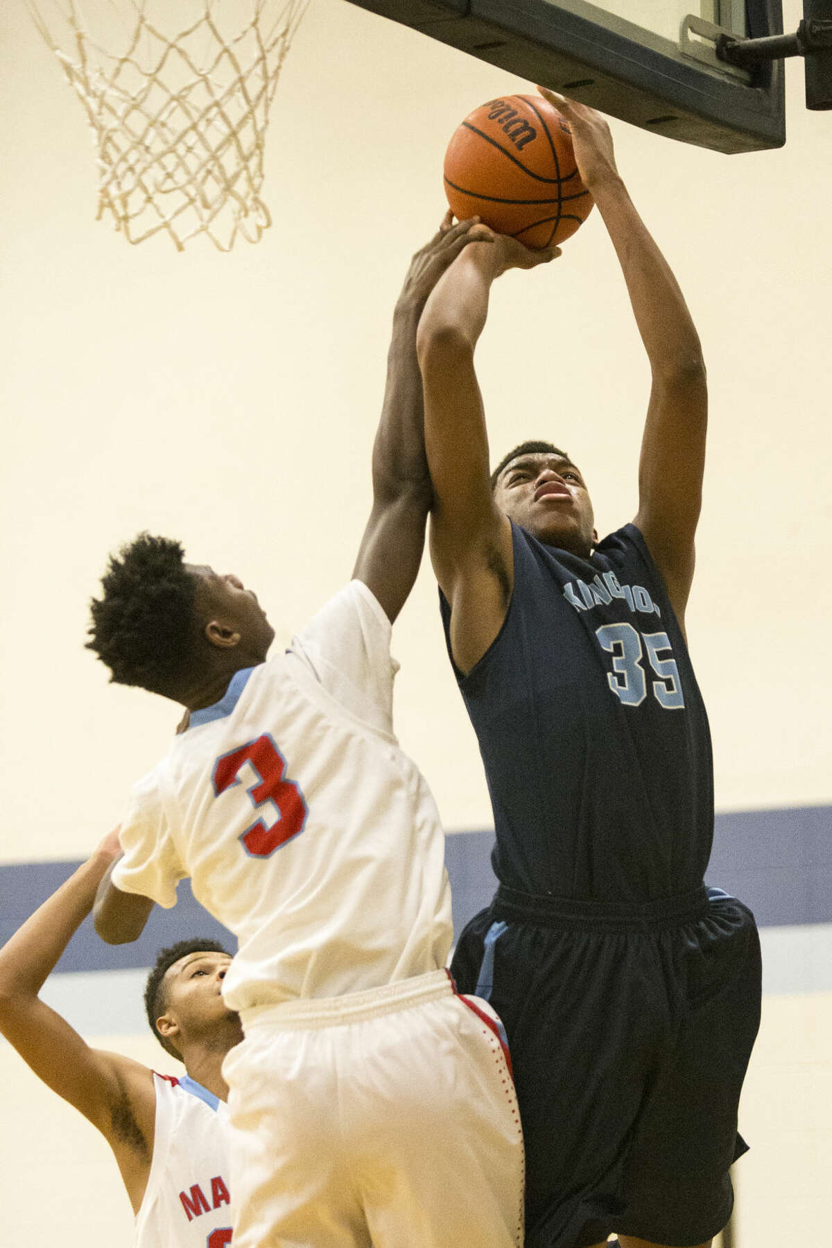 Kingwood's Fabian White (35) shoots a under the basket during their consolation matchup against Houston Madison in The Insperity Holiday Classic on Dec. 30, 2014, at Kingwood High School.