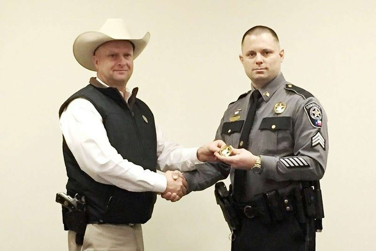 Corporal Kevin Sapp (right) was promoted to sergeant. Pictured with him is Montgomery County Pct. 4 Constable Rowdy Hayden.