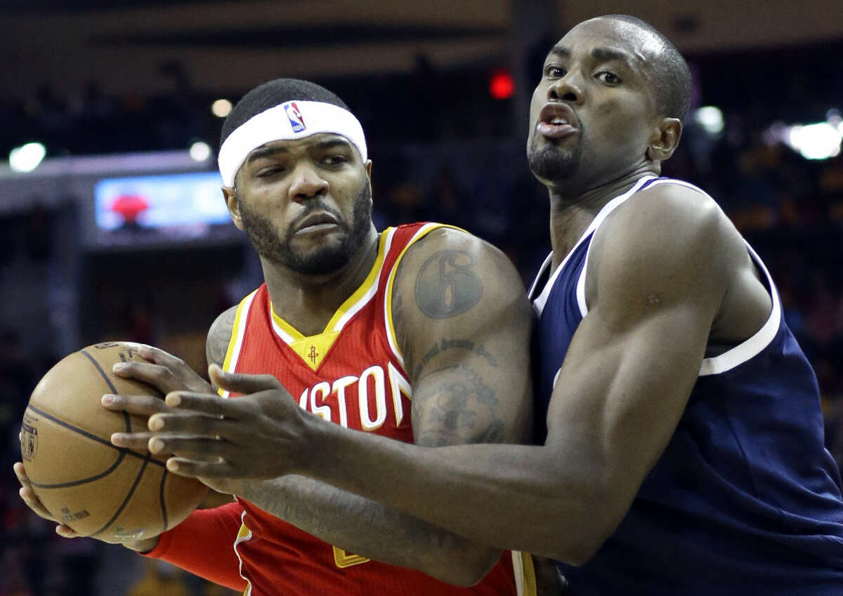 Houston Rockets' Josh Smith, left, is pressured by Oklahoma City Thunder's Serge Ibaka in the second half of an NBA basketball game Thursday, Jan. 15, 2015, in Houston. The Rockets won 112-101. (AP Photo/Pat Sullivan)