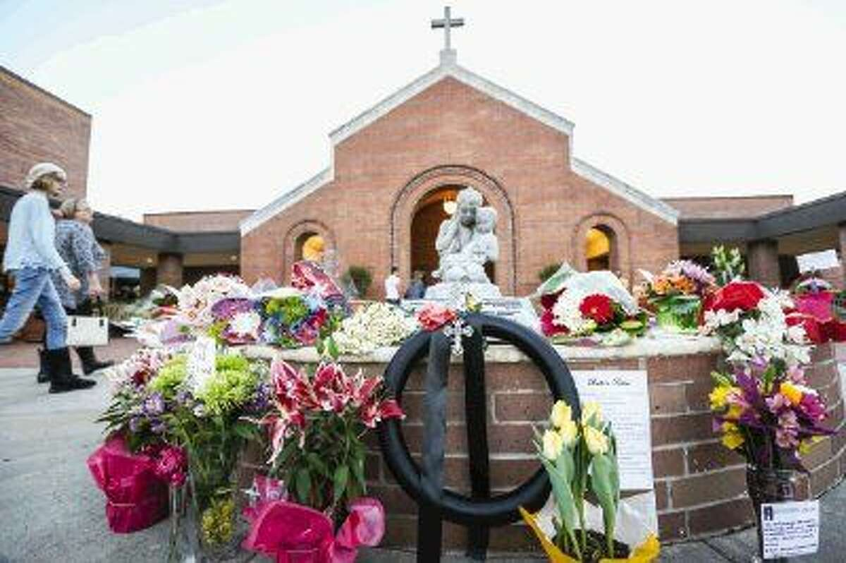 A temporary memorial made of flowers and letters of support is pictured on Sunday evening at St. Anthony of Padua Catholic Church in memory of Deacon Mike Mims, who died in a helicopter crash on the prior Friday.