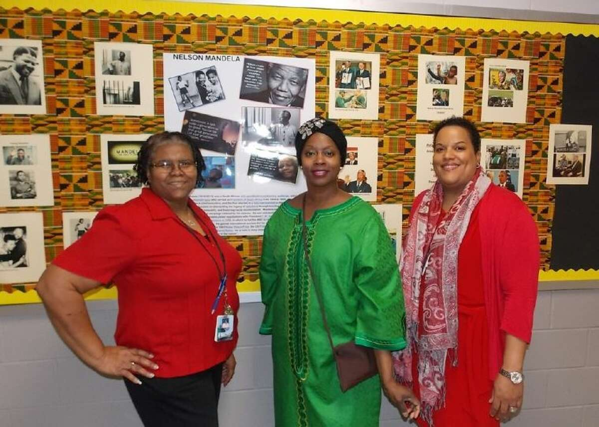 Shown at M.R. Wood near a Black History Month display are (from left): Business Teacher Marilyn Taylor, Special Education Teacher Angela Thomas-Davis and Lead Counselor Dr. Melissa Earls.