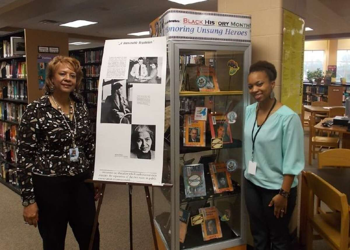 Marshall High School Librarian Yvonne Jackson and Library Assistant Lekecha Johnson stand near one of the many Black History Month displays in their school's library.