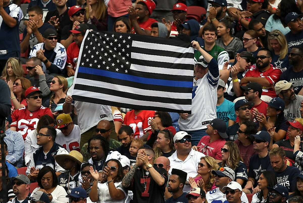Fans display a flag during the game between the Dallas Cowboys and San Francisco 49ers at Levi's Stadium on October 2, 2016 in Santa Clara, California.
