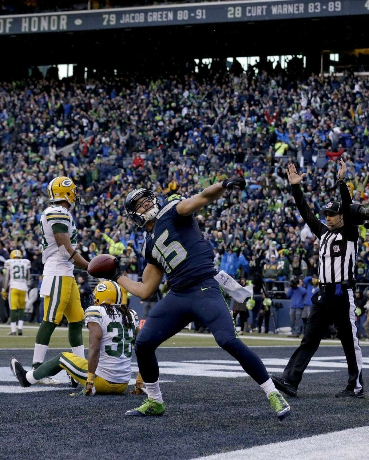 Seattle Seahawks wide receiver Jermaine Kearse throws the ball into the stands after scoring the game-winning touchdown against the Packers in overtime.