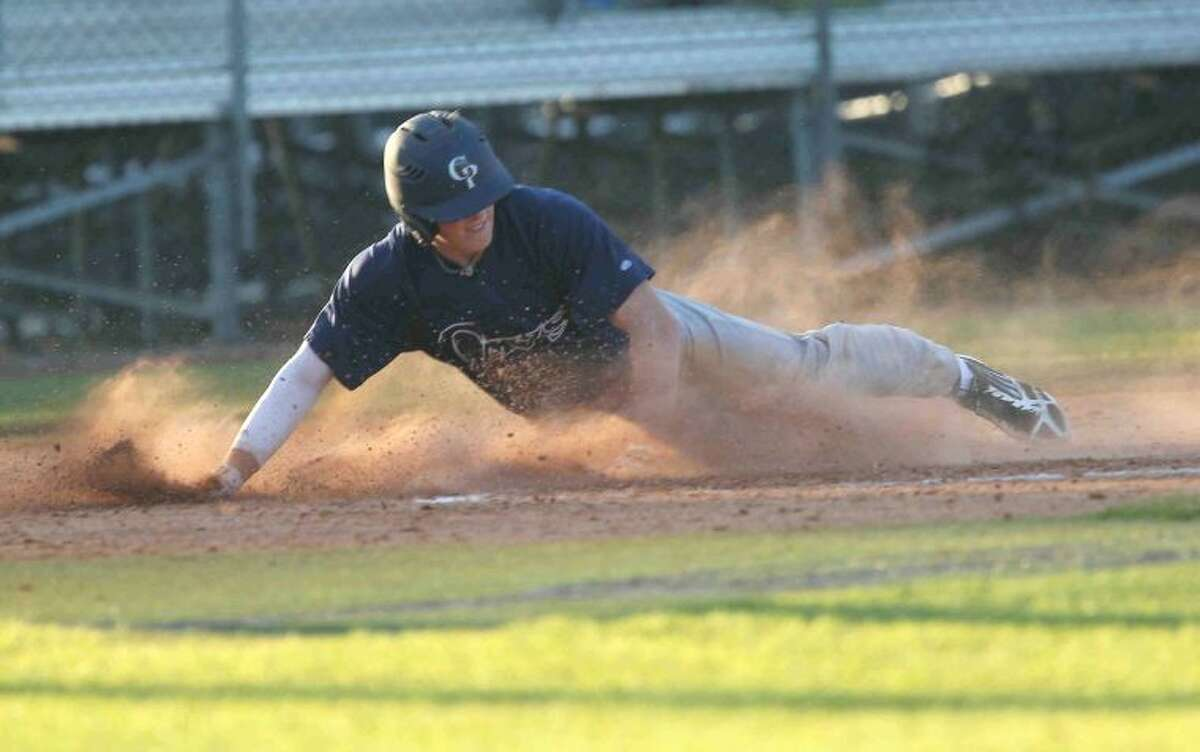 College Park's Ryder Lucas slides into home plate for a run in the third inning against Cy Creek at the Ferrell Classic tournament on Thursday. College Park defeated Cy Creek 9-1. To view or purchase this photo and others like it, visit HCNpics.com.