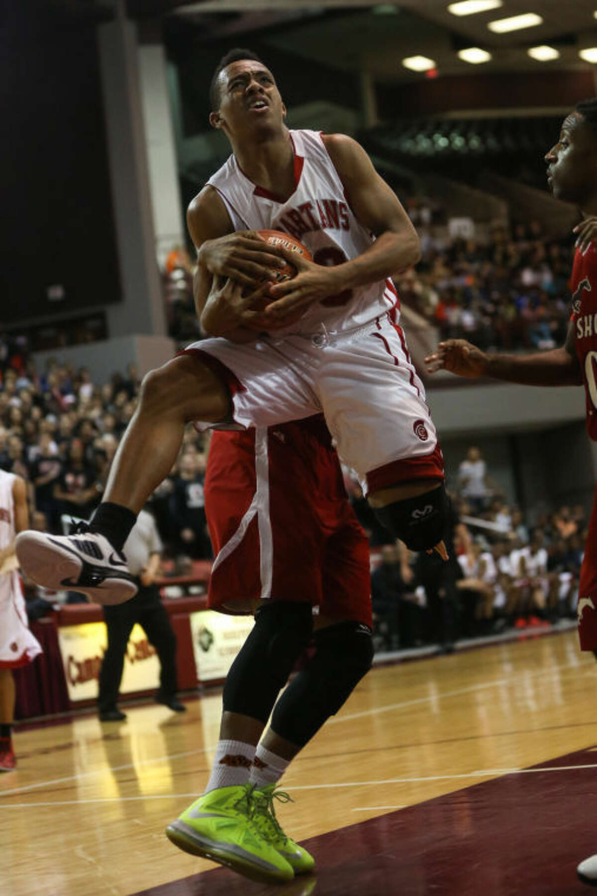 Cy Lakes' Nick Garth (3) is fouled while going for a layup North Shore on Friday at the Campbell Center. To view or purchase this photo and others like it, go to HCNPics.com. (Michael Minasi / HCN)
