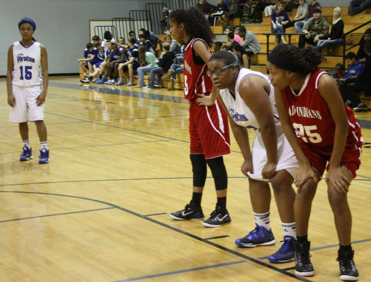 LaQuencia Martin (15) of the Lady Pirates watches teammate Emily Brawner (off picture) from afar while Simran Mayfield (5), Keke Adams (30) and Danyelle Gambrell (25) prepare to intercept the shot.