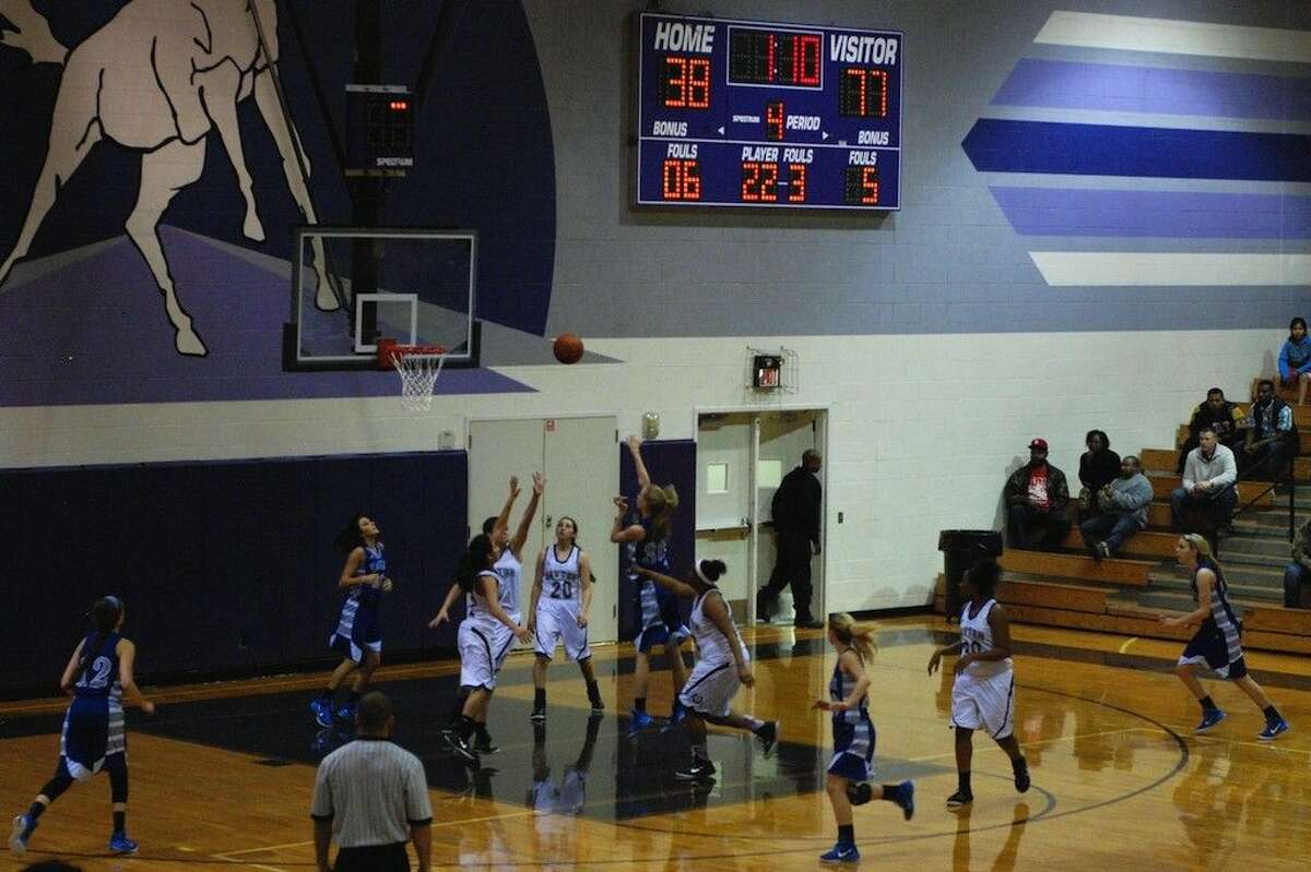 Madison Armer takes a shot for Barbers Hill late in the Lady Eagles, 77-41, victory at Dayton, Friday night, Jan. 16, 2015.