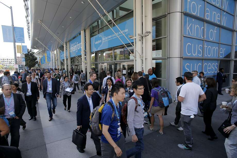 Attendees walk along Fourth Street as Dreamforce gets underway at the Moscone Center in downtown San Francisco in September 2015. Photo: Michael Macor, The Chronicle