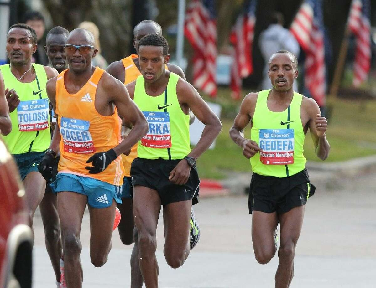 Birhanu Gedefa (far right), winner of the 2015 Chevron Houston Marathon, runs along with the lead pack along University Boulevard in Houston, Texas on Sunday, January 18, 2015. To view or purchase this photo and others like it, go to HCNPics.com.
